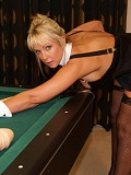 Kinky blonde slut posing on the pool table and riding on a gigantic thick dildo until she gets it all inside her