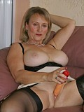 Gorgeous blonde milf gets lonely and plays with a huge dildo and her big tits