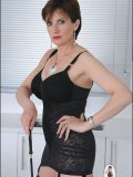 Incredibly appealing MILF armed with a crop whip models her see-through lingerie
