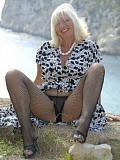 Incredible pictures of a horny mature housewife posing outdoors wearing just stockings
