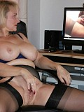 Naughty housewife enjoys watching a porno movie while twisting her huge nipples