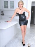 Mature dominatrix in black leather dress is ready to whip you like a cheap slut