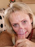 Horny blonde mature wife Michelle wraps her plump red lips around her hubby's thick cock