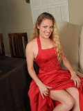 Horny chick strips off her red gown and exposes her tantalizing body figure on the couch!