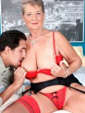 Dirty grandma goes for a ride on her young lovers lap after stripping