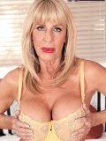 This busty blonde grandma gets herself a hunky man to teach a lesson to