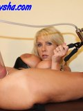 Blond kink pumps her shaven pussy up and plugs it with a huge hard rubber shlong