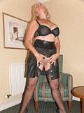 Amazing pics of a horny blonde housewife playing with her wet pussy in an armchair