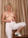 Horny bitch takes off her sport bra top and tight pants. See how seductive she is!