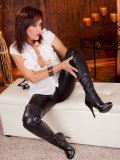 Mature fetish model fooling around with her spike heels and tight leather pants