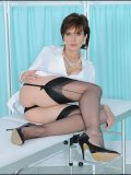 Mature doctor is waiting for you on the examination table in her sexy stockings