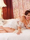 Naughty mature lady waiting for you in her bed, all dressed up in nylon and lace