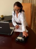 Serious office MILF eager to have some fun gets naked right on her working place