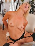 Cougar in stockings cant stop sticking fingers into her slightly fuzzy snatch