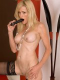 Cougar in black stockings inserts a working vibrator into her shaven pink slit