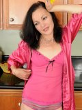 Sweet amateur mommy invites you into her kitchen and gets absolutely naked there