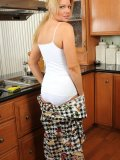 Sexy bitch in white pajamas strips and gets horny in the kitchen! Check out how hot she is!