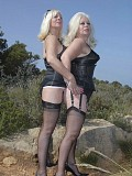 Gorgeous horny Sandy has a sexy friend join her in a hot lesbian picture set