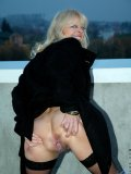Mature exhibitionist shows all her junk while posing on bridge over the highway