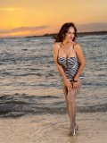 Hawaiian mommy Roni walks along the beach in her pantyhose and then strips down