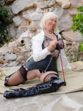 Nylon- and latex-loving older babe poses alfresco in the kinky outfit of a domme