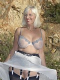 Provocative pictures of a mature housewife flashing her tits outdoors
