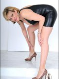 Mature Mistress appears in front of you with her crop whip and clad in rubber