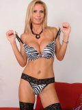 Alluring girl pulls off her zebra print bra and shows her wildest side in sexual fun!