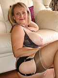 Naughty blonde mature housewife uses nylons to play with her husband's cock