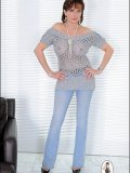 Even most usual outfits like jeans and knit top start looking kinky on this MILF