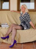 This gorgeous mature lady wants you in between her nylon-clad hips right now