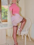 Luscious blond mother posing in stockings and see-through nightie in her bedroom