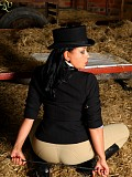 Sexy horse riding brunette Danica loves to tease her trimmed pussy with a horsewhip