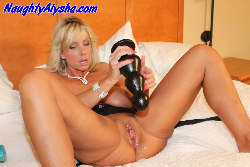 ... to shove the largest dildos she can find deep inside her slut pussy