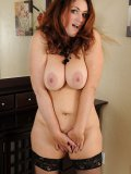 Chunky mature redhead dressed in lace is so eager to let you see her yummy slit