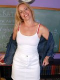 Mature teacher strips in classroom and measures her boobs! Want to know her size?