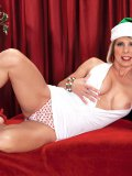 Petite mature bimbo strips naked for the holidays trying to be a naughty girl