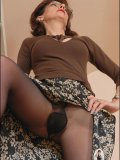 Mature lady with an impeccable body shows her pussy through sheer black nylon