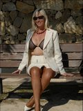 Crazy blonde milf Sandy doesn't mind showing her massive tits in public