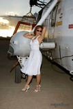 Incredible pics of a sassy brunette housewife showing off her hot body in a helicopter