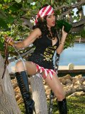 Super hot pictures of a horny brunette milf dressed up as a sexy pirate and posing outdoors
