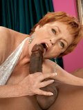 Seductive lady gets to taste the black stick and she even rides on it for more fun. Check it out!