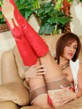 Mommys big red boots and tiny panties match perfectly with her beige stockings