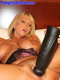 This insane blonde slut Alysha gets the world's biggest black dildo and gets it inside her wet pussy