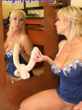 Sexy mommy sticks a huge dildo on a sucker to a mirror and impales herself on it