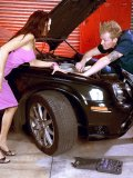 Big-dicked car mechanic allows his mature customer to pay him off with her ass