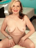 GILF Miranda Torri putting on a really great XXX show with her sheer pantyhose