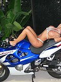 Slut shows off her curvy cougar body while riding a mean bike in a small bikini