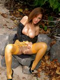 Ravishing brunette milf posing in stunning yellow stockings in a hot outdoors pics set