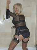 Horny blonde housewife getting naughty in the shower dressed in hot stockings